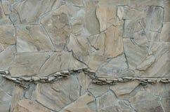 从不同的大小自然石头的背景  免版税库存照片