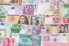 从世界的许多不同的货币钞票 库存图片