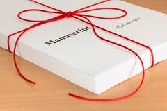 从作者的原稿有红色麻线的 免版税图库摄影