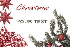 从分支圣诞树的圣诞节框架与在白色隔绝的红色星 图库摄影