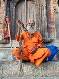从勒利德布尔Durbar广场尼泊尔加德满都古老宗教印度教贤哲修士的Sadhu 图库摄影