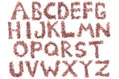 从咖啡豆的字母表 查出在白色 图库摄影