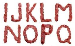从在白色背景隔绝的新鲜的肉的字母表 免版税图库摄影