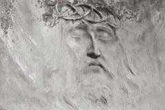 从墓碑的耶稣表面 免版税库存图片