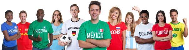 从墨西哥的足球迷有从其他国家的爱好者的 免版税图库摄影