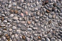 从小鹅卵石的路石纹理或无缝的背景的 图库摄影