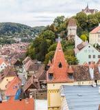 从尖沙咀钟楼的看法到老城市 Sighisoara市在罗马尼亚 免版税图库摄影