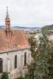 从尖沙咀钟楼的看法到老城市 Sighisoara市 库存照片