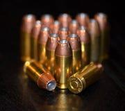从手枪的黄铜子弹 图库摄影