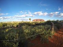 从日落观看的区域采取的岩石的风景看法 图库摄影