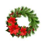 从杉木枝杈、莓果和一品红的圣诞节花圈开花 免版税库存图片