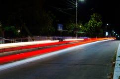 从汽车光的一串红色足迹 库存图片