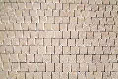 从灰色人为铺路石方形的形状的背景 免版税库存照片