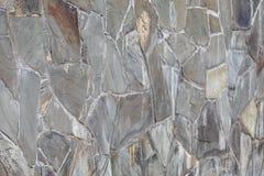 从灰色石头的墙壁与在水泥纹理背景透视的颜色口气 免版税图库摄影