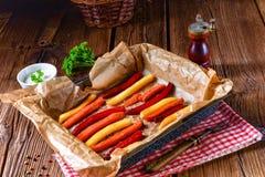 从烤箱的五颜六色的菜油炸物 免版税图库摄影