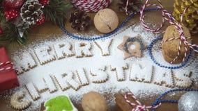 从燕麦曲奇饼的字法文本圣诞快乐 库存照片