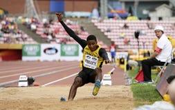 从牙买加胜利铜牌的韦恩PINNOCK在国际田联世界U20冠军的跳远决赛 免版税库存图片