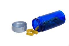 从瓶溢出的健康维生素 库存照片