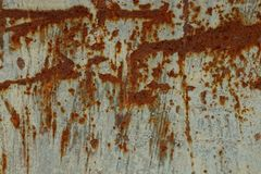 从生锈的铁墙壁的灰色棕色金属纹理 免版税库存照片