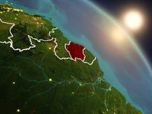 从空间的苏里南在日出期间 免版税库存图片