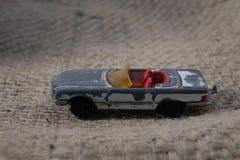 从童年打破的老金属车的一个玩具 图库摄影