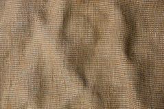 从粗麻布片断的灰色棕色织品纹理  库存照片