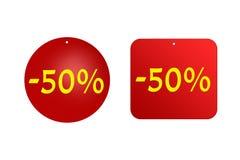 从红色贴纸的50%在白色背景 折扣和销售、假日和教育 免版税库存照片
