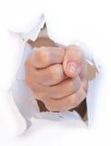从纸张的拳头 免版税库存照片