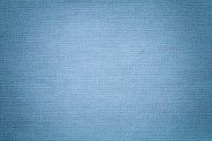 从纺织材料的浅兰的背景 与自然纹理的织品 靠山 免版税库存图片