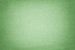 从纺织材料的浅绿色的背景 与自然纹理的织品 靠山 免版税库存图片