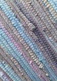 从织品小条缝合的布料  针线,材料再用  纺织品bac 库存照片