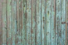 从老木板和被风化的油漆的美好的木纹理 免版税图库摄影