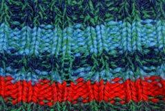 从老衣裳的色的羊毛镶边织品纹理 库存图片