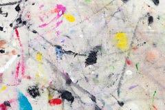 从色的油漆的污点在织品 库存图片