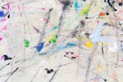 从色的油漆的污点在织品 库存照片