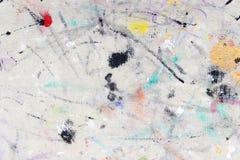 从色的油漆的污点在织品 免版税库存照片