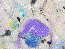 从色的油漆的污点在织品 免版税库存图片