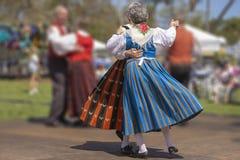 从芬兰遗产期间跳舞的精心制作的服装 免版税图库摄影