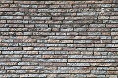 从花岗岩砖11的墙壁 免版税库存照片
