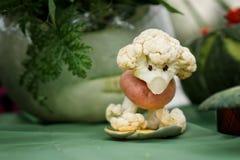 从花椰菜的长卷毛狗 库存图片