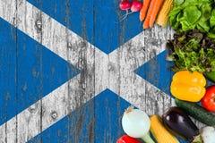 从苏格兰的新鲜蔬菜在桌上 烹调在木旗子背景的概念 图库摄影