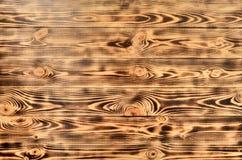 从被烧焦的杉木板的光线电话机 库存照片