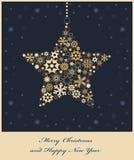 从金黄雪花的圣诞节星形 库存照片