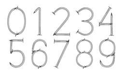 从钉子特写镜头的数字在白色背景 图库摄影