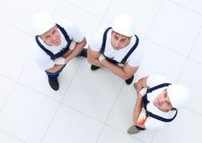 从顶的小组的看法建筑工人 免版税库存图片