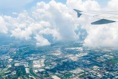 从飞机的多云和风景 库存照片