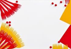 从黄色和红色叉子的塑料设备 免版税库存图片