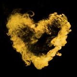 从黄色烟的心形 库存照片