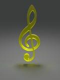 从黄色玻璃的高音谱号 免版税图库摄影