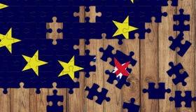 从EU旗子和英国旗子的缺掉部分的难题在星形状的 免版税库存图片